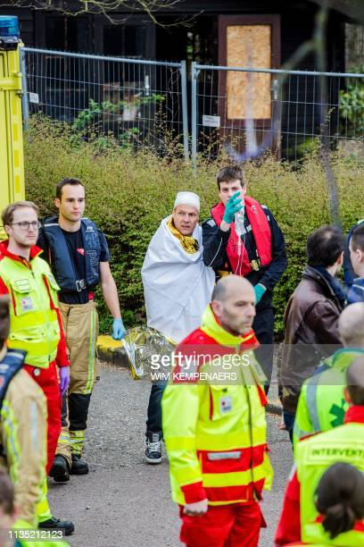 People, injured after two zodiac speed boats crashed into each other on the Scheldt river, receive medical assistance on April 5, 2019 in the city...