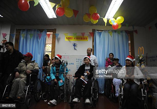 People injured in the May 12 earthquake watch performance during a Christmas charity evening party at the rehabilitation center of Sichuan Province...