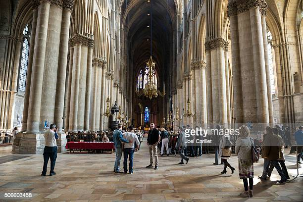 people inside reims cathedral in france - reims cathedral stock pictures, royalty-free photos & images