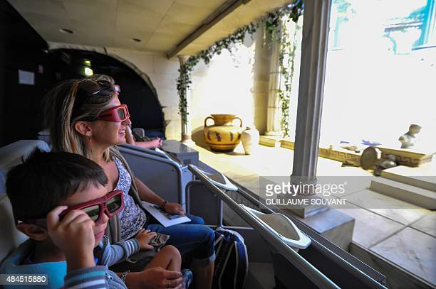 People inside the attraction derived from the video game Les Lapins Cretins created by Ubisoft at the Futuroscope theme park on August 19 2015 in...