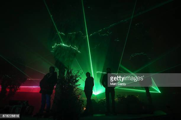 People inside the Mediterranean Biome look at the lasers from the Eden Festival of Light and Sound at the Eden Project near St Austell on November 23...