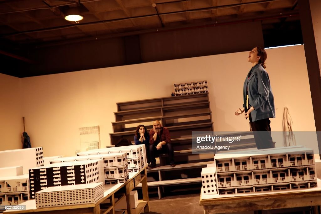 People inspect artworks during ARCOmadrid 2018 in Madrid, Spain on February 21, 2018.