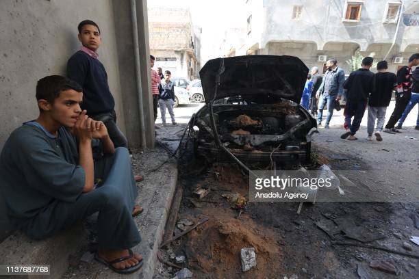 People inspect damage after East Libya-based forces led by commander Khalifa Haftar carried out rocket attacks at the Abu Salim neighborhood in...