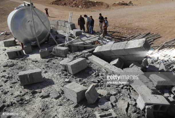People inspect debris of a building at Darbandikhan district of Suleymaniyah after an earthquake measuring 73 on the Richter scale rocked northern...
