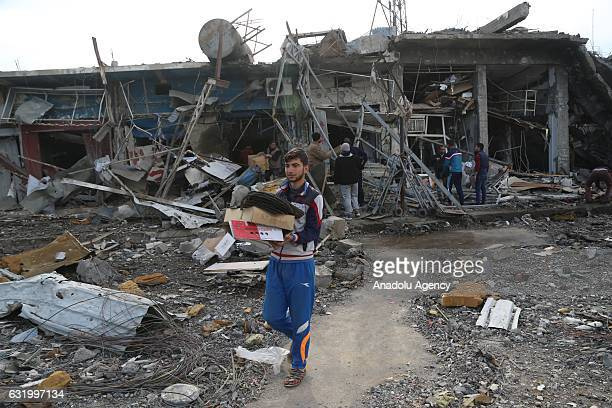 People inspect debris of buildings after clashes between Iraqi army forces and Daesh terrorists at AlZuhur neighborhood near Mosul Iraq on January 18...