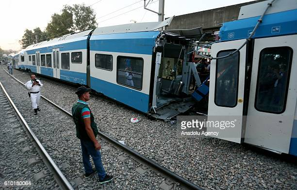 People inspect the accident site after two passenger train collided in Boudouaou town of Algeria on September 24 2016 The accident left deaths and...