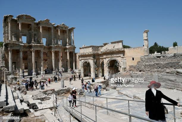 People inspect the Ancient Ephesus City Ruins which was used as a settlement for 9000 years and take place in World Heritage List of UNESCO World...
