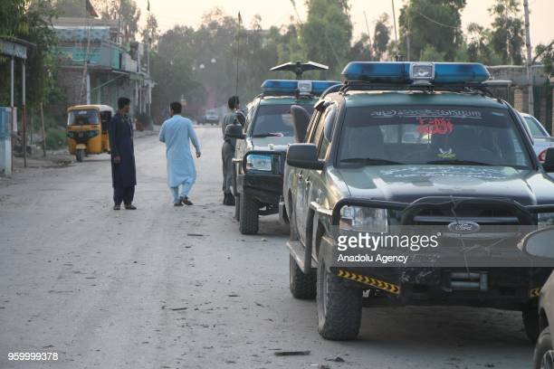 People inspect the area after three blasts which killed 8 at the Afghan cricket stadium in Jalalabad city center of Nangarhar province eastern...
