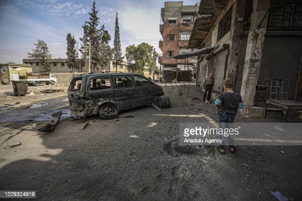 People inspect the damage after Assad Regime and Iran backed terrorist's artillery fire hits deescalation zone in Idlib Syria on October 28 2020 At...