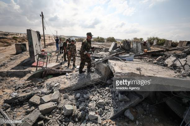 People inspect the damaged buildings after Israeli forces conducted airstrikes in Rafah, Gaza on September 17, 2018.