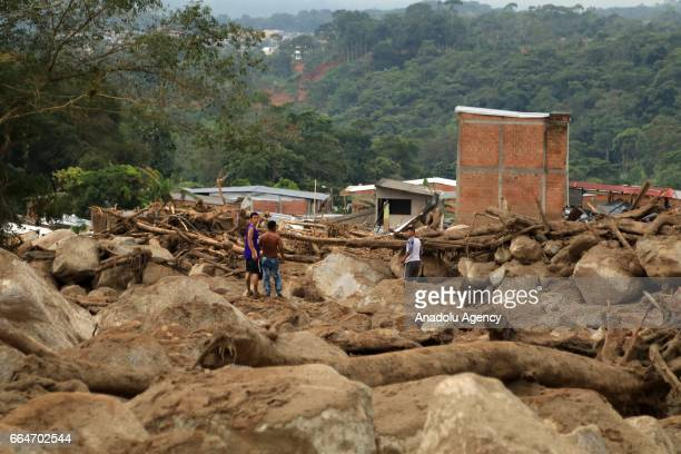 People inspect the damaged site at Mocoa after the flood in Putumayo of Colombia on April 03 2017 At least 273 people lost their lives after three...