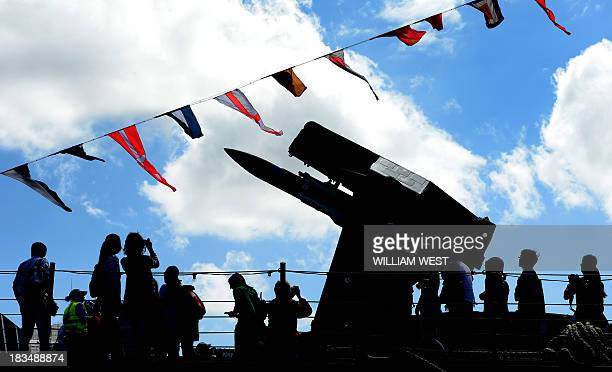 People inspect the HMAS Darwin at Royal Australian Navy's Sydney base of Garden Island during an open day after the Navy celebrated 100 years since...