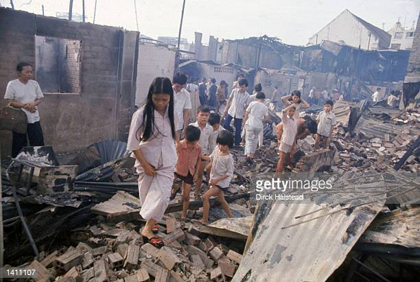 People inspect the remains of their homes and neighborhood April 1975 in Saigon American involvement in the Vietnam War came to an end when troops...