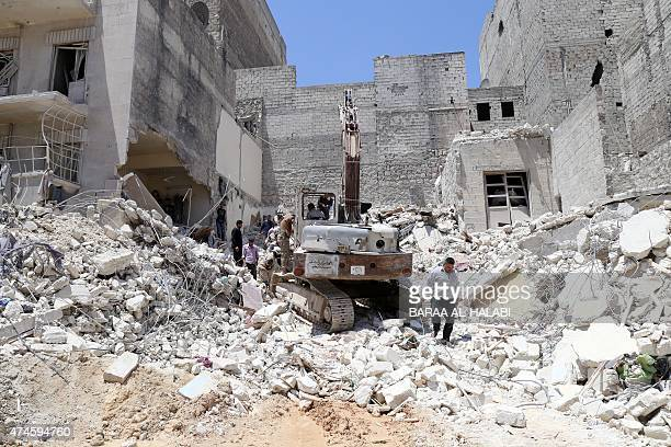 People inspect the rubble of collapsed buildings following a reported airstrike by government forces on May 24 in the rebelheld alSukari neighborhood...