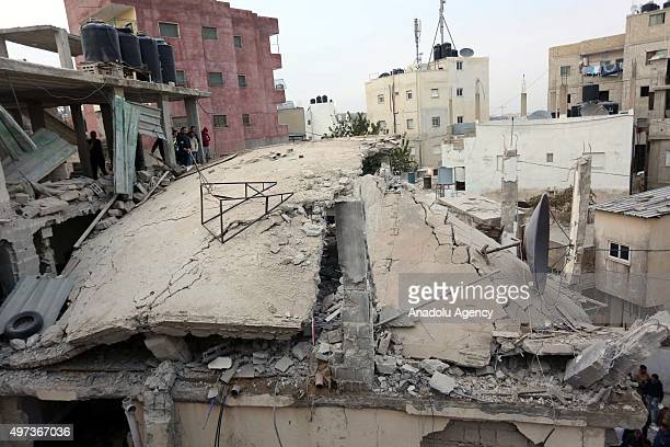 People inspect the rubble of the house of Muhammad Ebu Sahin who allegedly killed an Israeli in June after it was demolished by Israeli authority at...