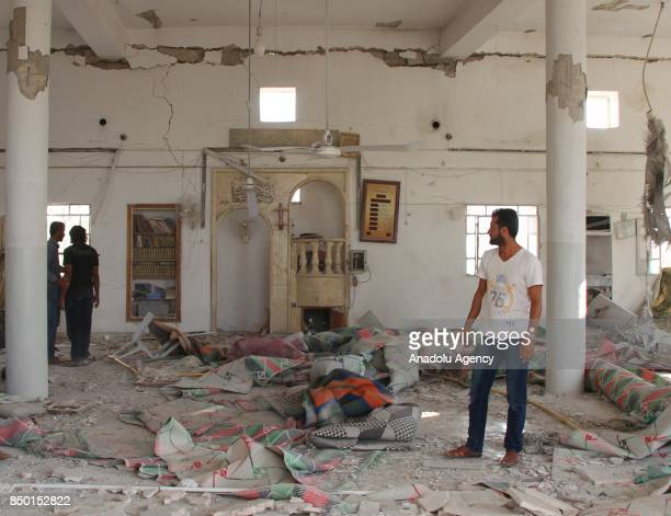 People inspect the scene after Abu Bakr AsSiddiq Mosque was hit with an air strike in Idlib Syria on September 20 2017 It is reported that at least 2...