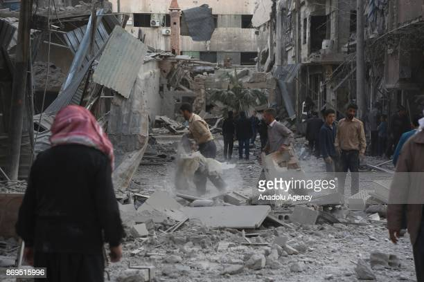 People inspect the scene after an attack carried out by Assad regime forces hit a deescalation zone in Douma town of Eastern Ghouta in Damascus Syria...