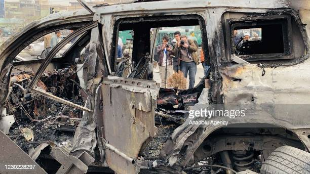 People inspect the site after a bomb-laden car exploded in Afghanistan's capital Kabul, killing at least nine and injuring 20, including Afghan...
