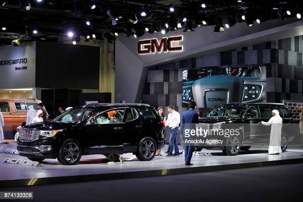 People inspect the vehicles during the Dubai International Motor Show 2017 at Dubai World Trade Centre in Dubai United Arab Emirates on November 14...