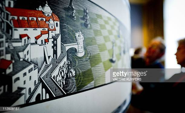 People install the artwork of graphic artist Maurits Cornelis Escher 'Metamorphosis III' at the Museum Escher in the Palace in The Hague on April 19...
