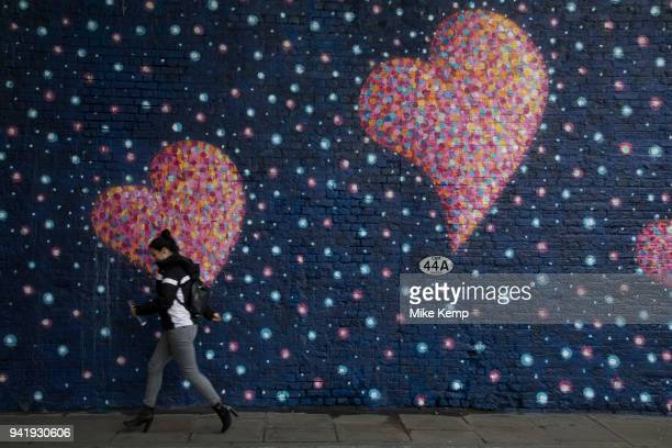 People interact with a mural at Borough Market which serves as a personal dedication and homage to the terror attack at London Bridge by graffiti...