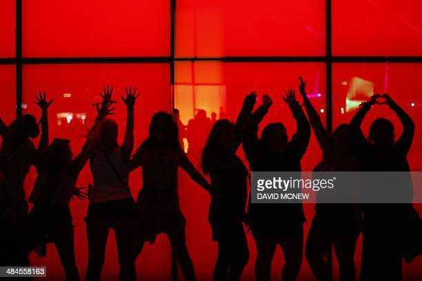 People interact with lighted art at the Coachella Valley Music Arts Festival at the Empire Polo Club in Indio California April 12 2014 The annual...