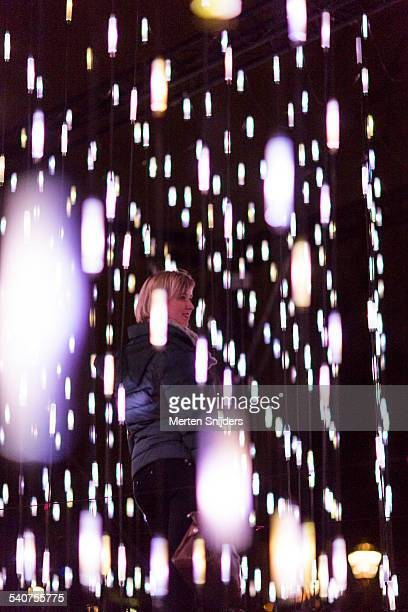 People interacting with light installation