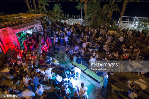 People into Cala Junco a beach where you go dancing during the nightlife in the Via Marina The Via Marina of Reggio Calabria consists of the four...