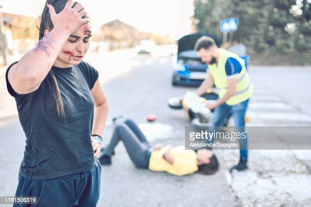 people involved in car accident still hurt and shocked from the events - gory car accident photos stock pictures, royalty-free photos & images