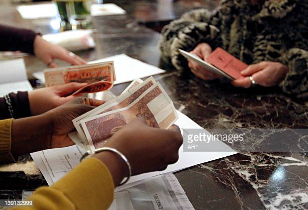 People is at the counter in a branch of the Banque de France in Paris on February 16 2012 to convert French old banknotes in francs to euros...