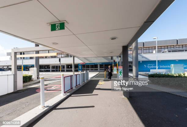 Sydney, Australia - June 13, 2017: People is coming back to car park after see friends off. Took at departure area of Sydney International Airport in a sunny day.