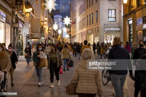 People is seen walking on the street on December 17, 2020 in Sevilla .