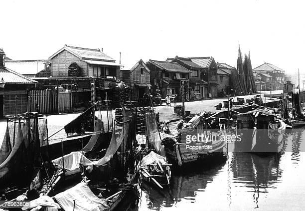 circa 1930's Yokohama Japan Fishing boats on a canal