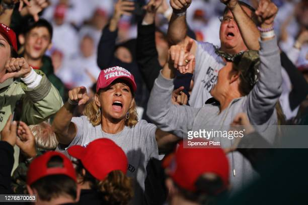 People jeer at the media as President Donald Trump speaks at a rally at Harrisburg International Airport on September 26 2020 in Middletown...