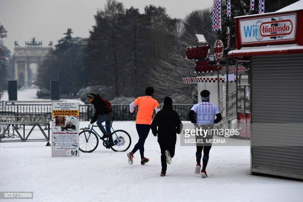 People jog in Sempione garden after snowfall in Milan on March 1 2018 Fresh heavy snowfalls and icy blizzards were expected to lash Europe on March 1...