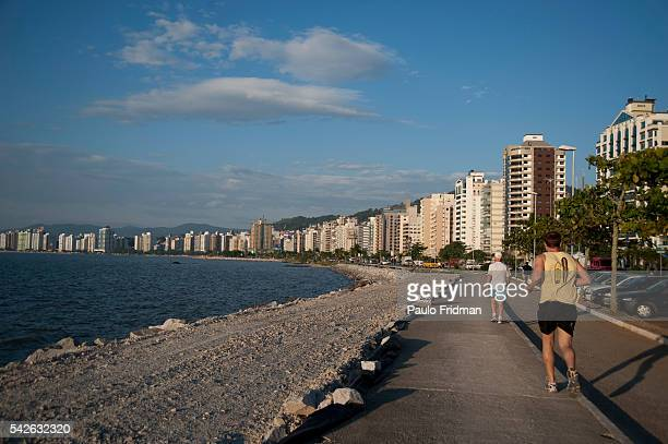 People jog on Beira Mar Avenue in Florianopolis Brazil