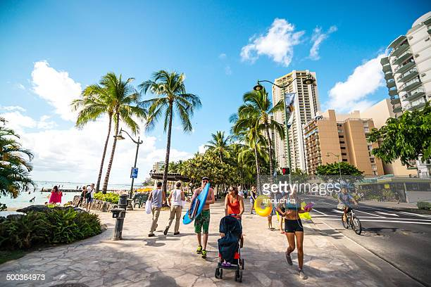 people jogging, cycling and walking, waikiki beach - honolulu stock pictures, royalty-free photos & images