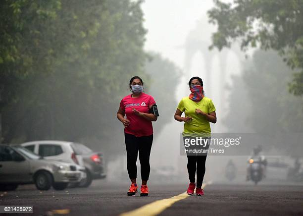 People jogging in a foggy morning at India Gate as smog covers the capital's skyline on November 6 2016 in New Delhi India New Delhi's air quality...