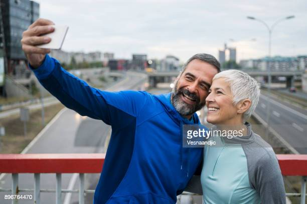people jogging outdoors - 50 59 years stock pictures, royalty-free photos & images