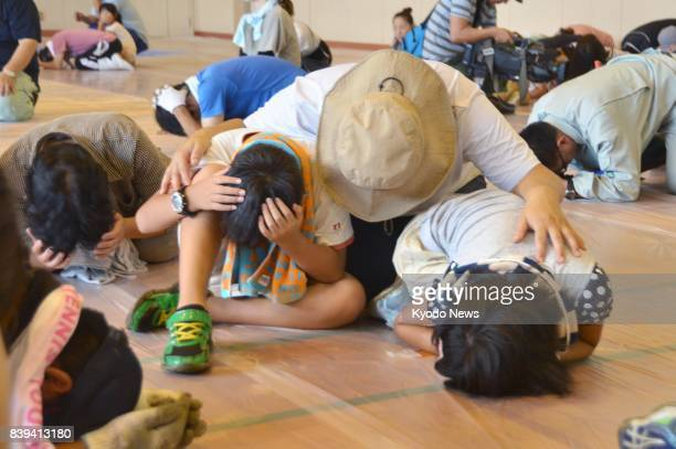 People join an emergency drill to prepare for a North Korean ballistic missile launch in the central Japan city of Tsu on Aug 26 2017 The drill was...