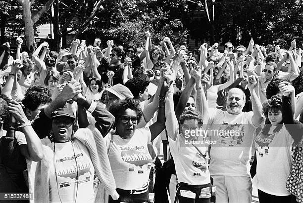 People join hands at the 'Hands Across America' benefit event helping to raise money for local charities, New York City, USA, 25th May 1986.