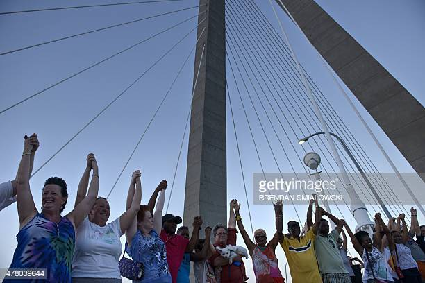 People join hands on Arthur Ravenel Jr Bridge June 21 2015 in Charleston South Carolina People crossed the Bridge from Mount Pleasant and Charleston...