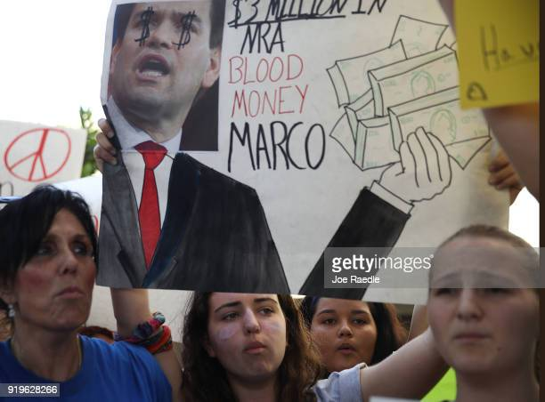 People join together after a school shooting that killed 17 to protest against guns on the steps of the Broward County Federal courthouse on February...