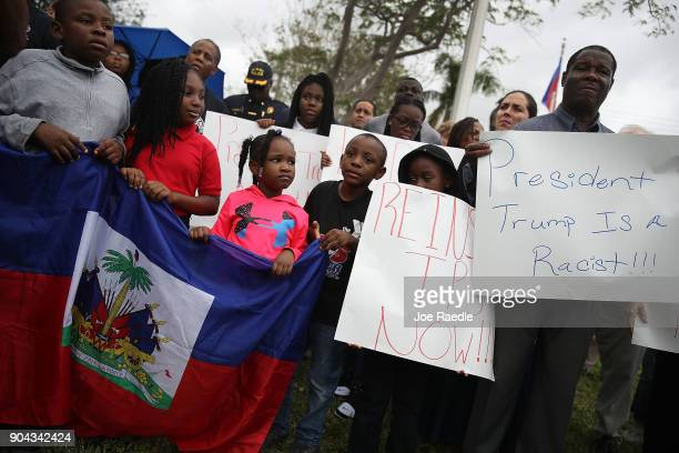 People join together to mark the 8th anniversary of the massive earthquake in Haiti and to condemn President Donald Trump's reported statement about...