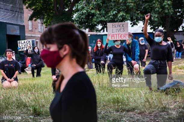 People joining a Black Lives Matter demonstration and 8 minute vigil on 3rd June 2020 in Crouch End, London, United Kingdom. The death of an...