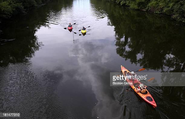 People kayak on the Charles River on the Newton/Needham line