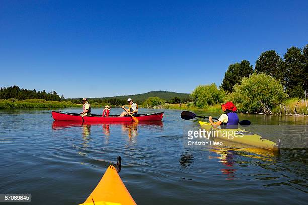 people kayaking and canoeing on a river. - bend oregon stock photos and pictures