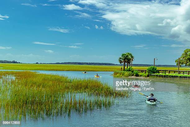 people kayaking in lake against sky - file:myrtle_beach,_south_carolina.jpg stock pictures, royalty-free photos & images