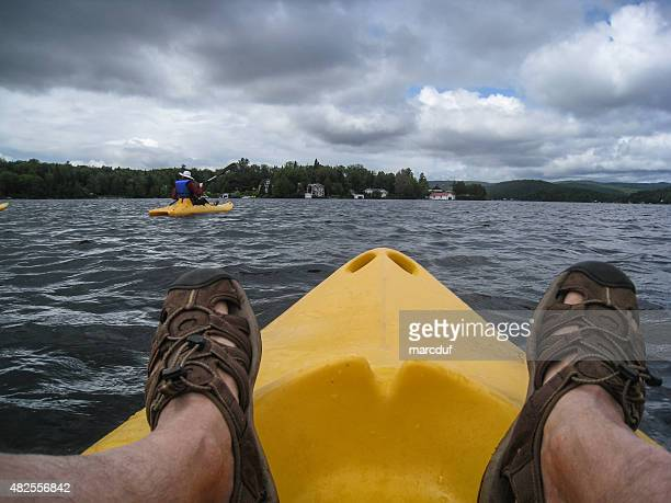 People kayaking on a lake from personal point of view