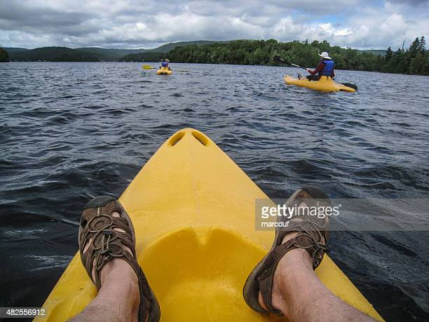 people kayaking on a lake from personal point of view - mujeres fotos stock pictures, royalty-free photos & images